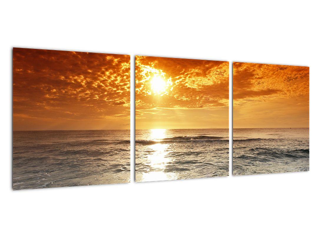 Obraz piesočného pobrežia pri západe slnka