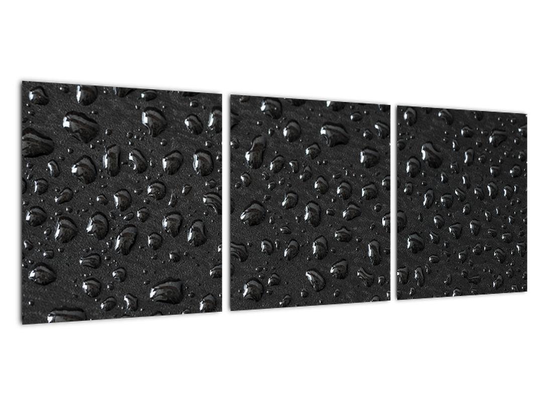 Obraz kvapiek na čiernom povrchu