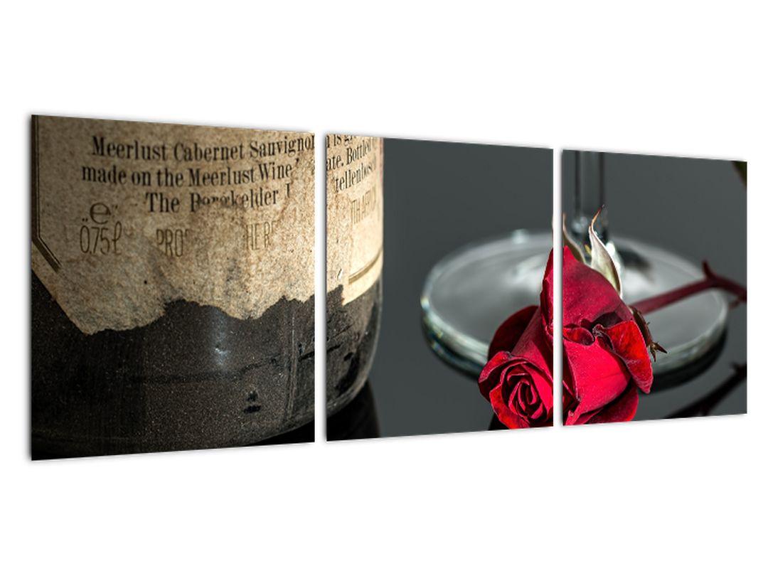 Červená ruža na stole - obrazy do bytu